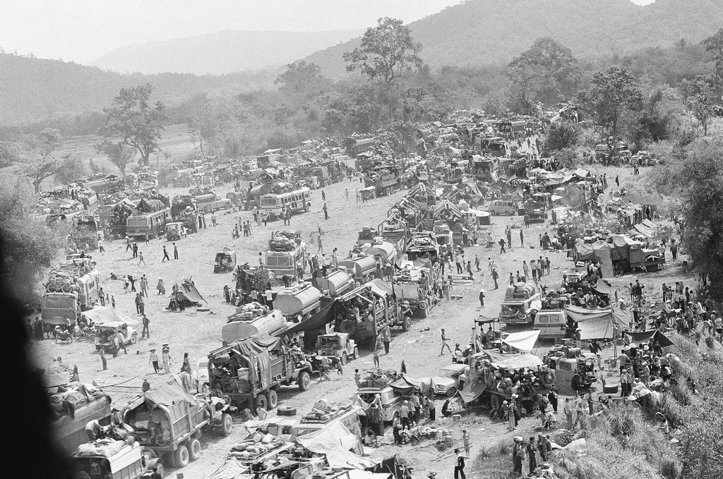 . Hundreds of vehicles of all sports fill an empty area as the refugees fleeing in the vehicles pause near Tuy Hoa in the central coastal region of South Vietnam, Saturday, March 23, 1975 following the evacuation of Banmethuout and other population centers in the highlands to the west. (AP Photo/Ut)