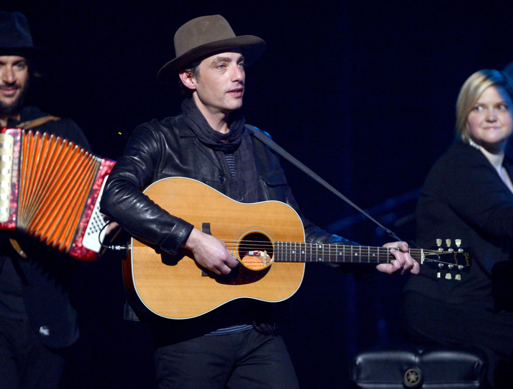 Description of . Musician Jakob Dylan performs osntage during a celebration of Carole King and her music to benefit Paul Newman's The Painted Turtle Camp at the Dolby Theatre on December 4, 2012 in Hollywood, California.  (Photo by Michael Buckner/Getty Images for The Painted Turtle Camp)