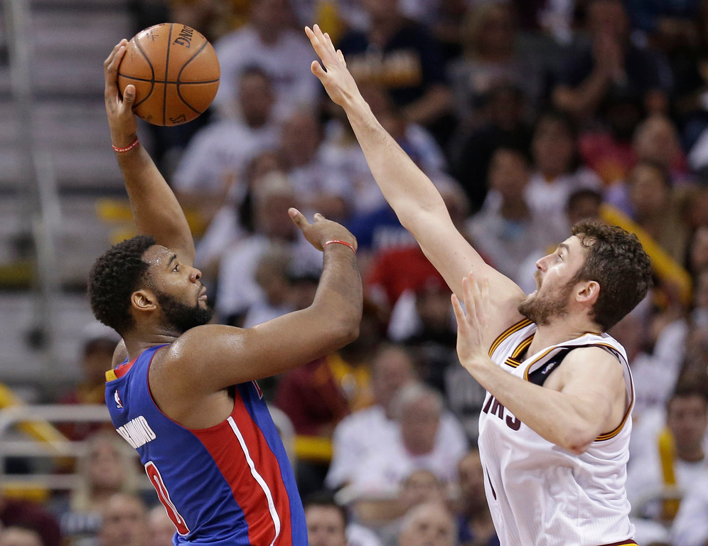 . Detroit Pistons\' Andre Drummond, left, shoots over Cleveland Cavaliers\' Kevin Love in the first half in Game 2 of a first-round NBA basketball playoff series, Wednesday, April 20, 2016, in Cleveland. (AP Photo/Tony Dejak)