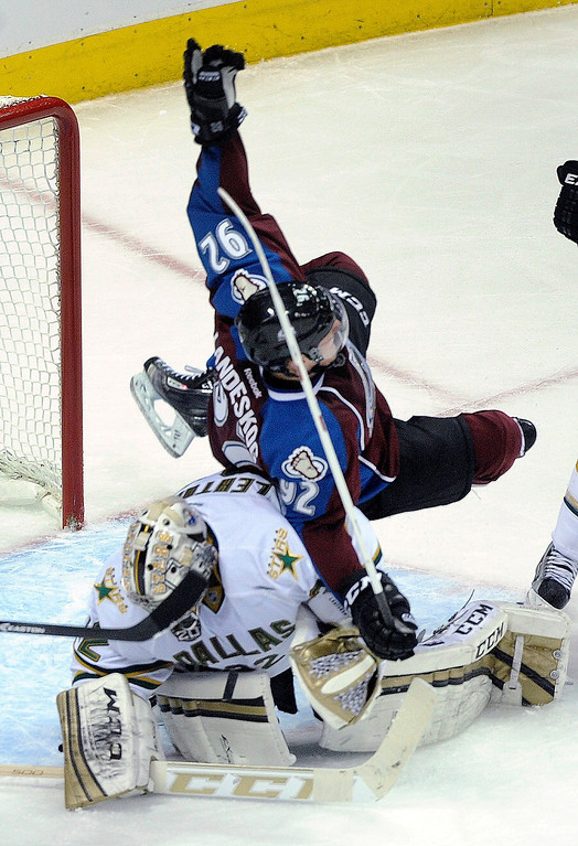 . DENVER, CO. - MARCH 12: Gabriel Landeskog (92) of the Colorado Avalanche flipped over goalie Kari Lehtonen (32) of the Dallas Stars in the first period. Landeskog was called for goaltender interference. The Colorado Avalanche hosted the Dallas Stars Wednesday night, March 19, 2013 at the Pepsi Center in Denver. (Photo By Karl Gehring/The Denver Post)