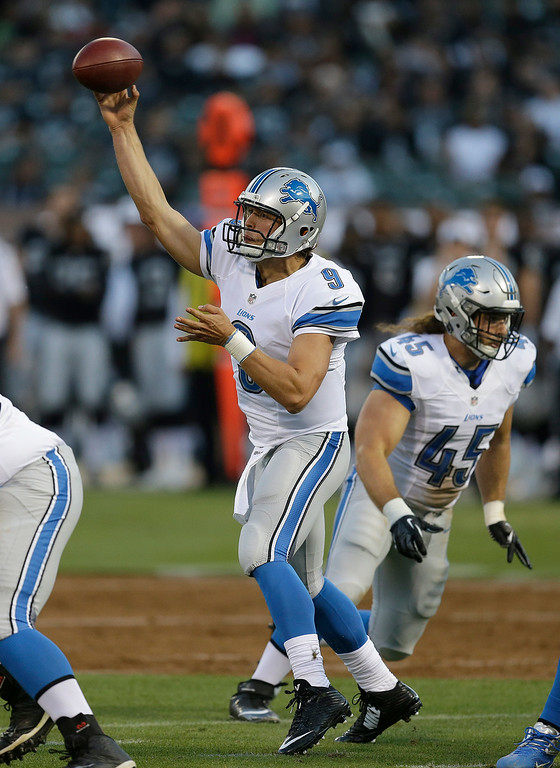 . Detroit Lions quarterback Matthew Stafford (9) passes against the Oakland Raiders during the first half of an NFL preseason football game in Oakland, Calif., Friday, Aug. 15, 2014. (AP Photo/Ben Margot)