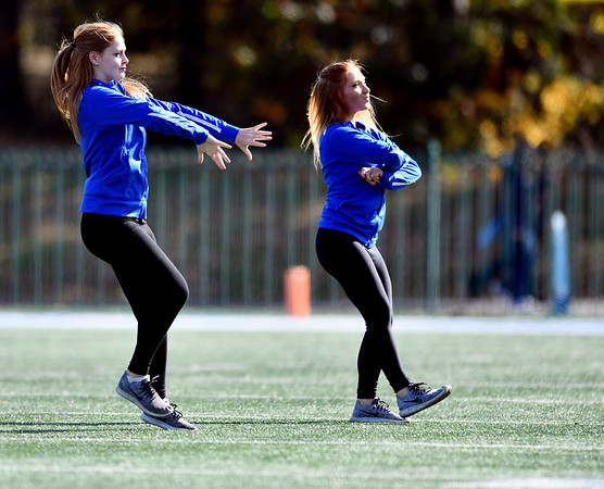 10/26/2019 Mike Orazzi | Staff Central Connecticut State University Dance Squad members perform during Saturday's football game with Long Island University in New Britain.