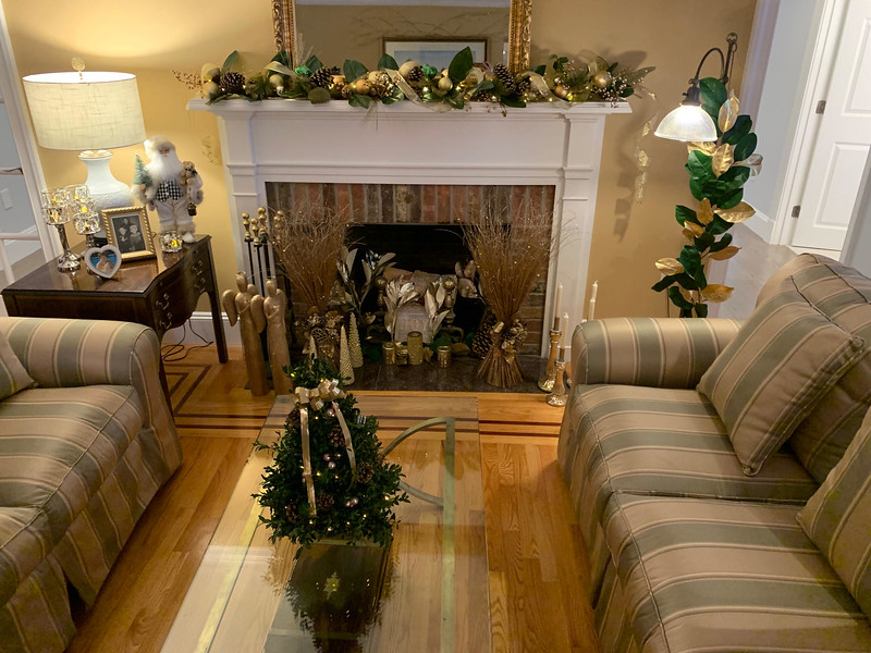 Gold and green greet those who enter the living room.