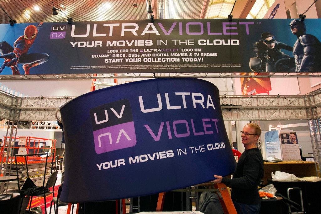 . Workers prepare an UltraViolet booth in the lobby of the Las Vegas Convention Center for the International CES in Las Vegas, Nev., on Jan. 5, 2013. UltraViolet is a cloud-based licensing system that allows users to stream videos to multiple devices. (REUTERS/Steve Marcus)