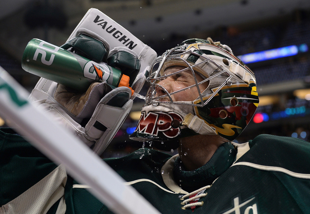 . Minnesota goalie Darcy Kuemper hydrated before the first period. The Minnesota Wild hosted the Colorado Avalanche at the Xcel Energy Center in St. Paul Monday night, April 21, 2014. (Photo by Karl Gehring/The Denver Post)