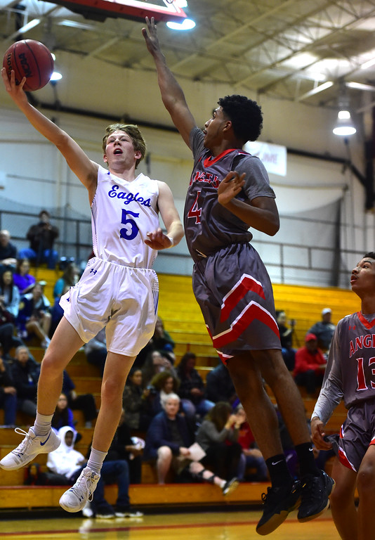 . Broomfield High School\'s Grant Swenson goes up for a shot against Denver East\'s Ja\'Shawn Chisel during their game in the Fairview Festival on Wednesday. For More photos go to bocopreps.com Paul Aiken Staff Photographer Dec 6 2017