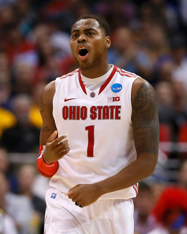 . Ohio State Buckeyes forward Deshaun Thomas celebrates against the Arizona Wildcats in the second half of their West Regional NCAA men\'s basketball game in Los Angeles, California March 28, 2013. REUTERS/Lucy Nicholson
