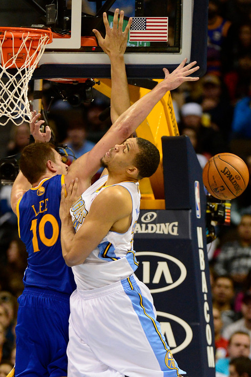 . Denver Nuggets center JaVale McGee (34) Golden State Warriors power forward David Lee (10) during the second half of the Nuggets\' 116-105 win at the Pepsi Center on Sunday, January 13, 2013. AAron Ontiveroz, The Denver Post
