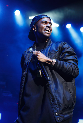 . Big Sean on stage with at DTE Energy Music Theatre on Saturday, Aug. 31, 2013. Photo by Ken Settle