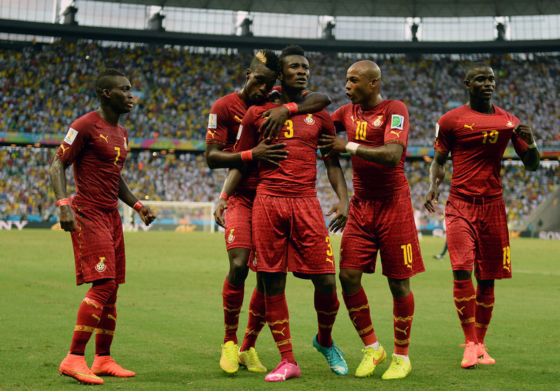 . Ghana\'s midfielder Asamoah Gyan (C) is congratulated by teammates after scoring during a Group G football match between Germany and Ghana at the Castelao Stadium in Fortaleza during the 2014 FIFA World Cup on June 21, 2014. (CARL DE SOUZA/AFP/Getty Images)