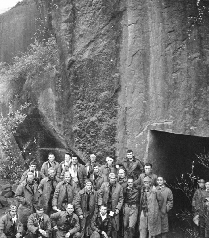 . FILE - In this April 22, 1943 image provided by the U.S. Army Air Forces, Maj. Gen. James Doolittle\'s Tokyo raiders who finally ended their spectacular flight in China are grouped outside a shelter carved from a mountainside.  Thousands of visitors streamed to the national Air Force museum on Saturday, Nov. 9, 2013 to pay a Veterans Day weekend tribute to the few surviving members of the Doolittle Raiders, airmen whose daring raid on Japan helped boost American morale during World War II, as they planned to make their ceremonial final toast together.  Only four of the 80 Raiders are still living, and one was unable to attend because of health issues.  (AP Photo/U.S. Army Air Forces)
