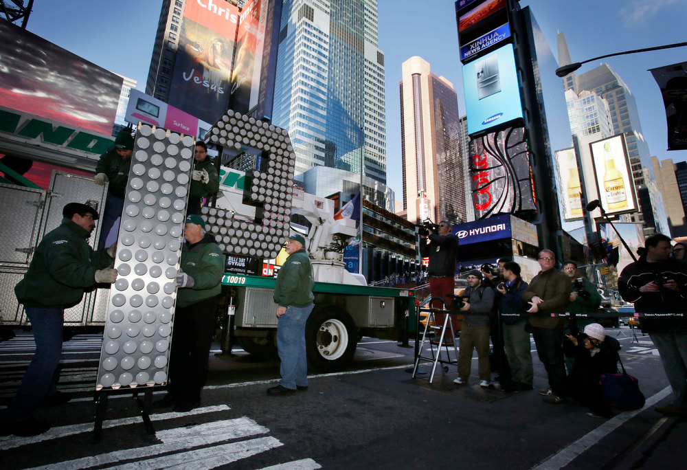 "Description of . Workers unload the number ""13\"" to be used during the New Year\'s Eve celebration in Times Square in New York, Wednesday, Dec. 19, 2012.  (AP Photo/Seth Wenig)"