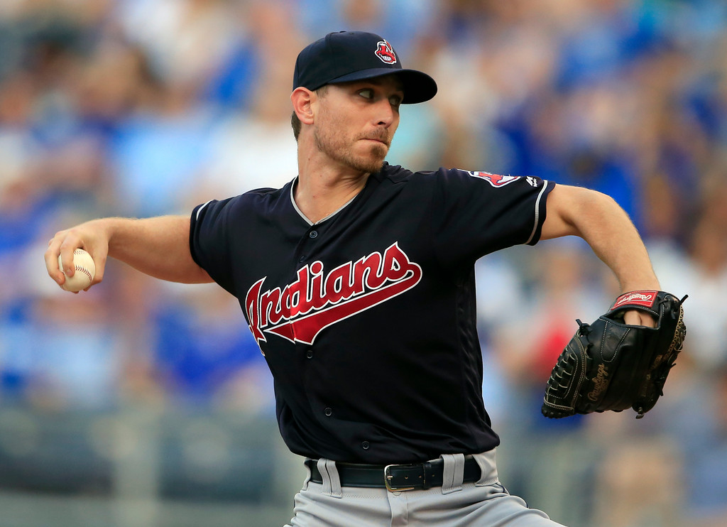 . Cleveland Indians starting pitcher Josh Tomlin delivers to a Kansas City Royals batter during the first inning of a baseball game at Kauffman Stadium in Kansas City, Mo., Friday, June 2, 2017. (AP Photo/Orlin Wagner)