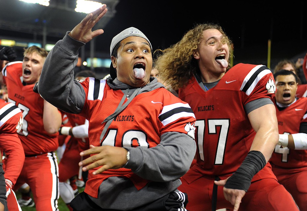 . Redlands East Valley High School\'s Jospeh Price, right, celebrates with teammates after defeating Clayton Valley Charter 34-33 for the CIF-State Division II championship title on Saturday, December 20, 2014 at StubHub Center in Carson, Ca. (Photo by Micah Escamilla/Redlands Daily Facts)