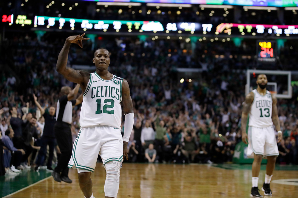 . Boston Celtics guard Terry Rozier, left, reacts after sinking a three-point shot during the second half in Game 2 of the NBA basketball Eastern Conference finals against the Cleveland Cavaliers, Tuesday, May 15, 2018, in Boston. (AP Photo/Charles Krupa)
