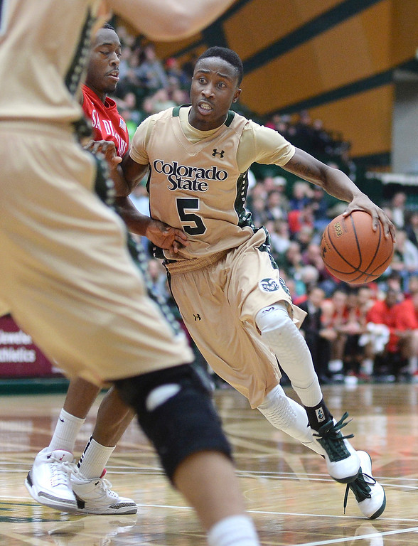 . Rams\' junior guard Jon Octeus (5) worked the ball inside during the second half. The Colorado State men\'s basketball team fell 71-61 to San Diego State Wednesday night, January 1, 2014. Photo By Karl Gehring/The Denver Post