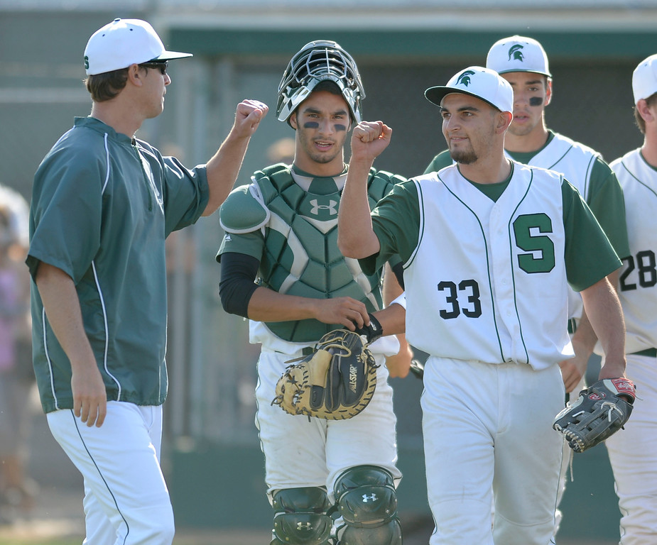 . South\'s closer Jake Mandel (33) gets fist bumps after closing out against Estancia in a first-round CIF SS Division IV baseball game Friday in Torrance. South won 7-2. 20130517 Photo by Steve McCrank / Staff Photographer