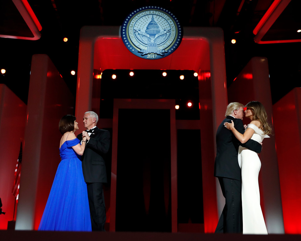 . President Donald Trump dances with first lady Melania Trump as Vice President Mike Pence dances with his wife Karen at the Liberty Ball, Friday, Jan. 20, 2017, in Washington. (AP Photo/Alex Brandon)