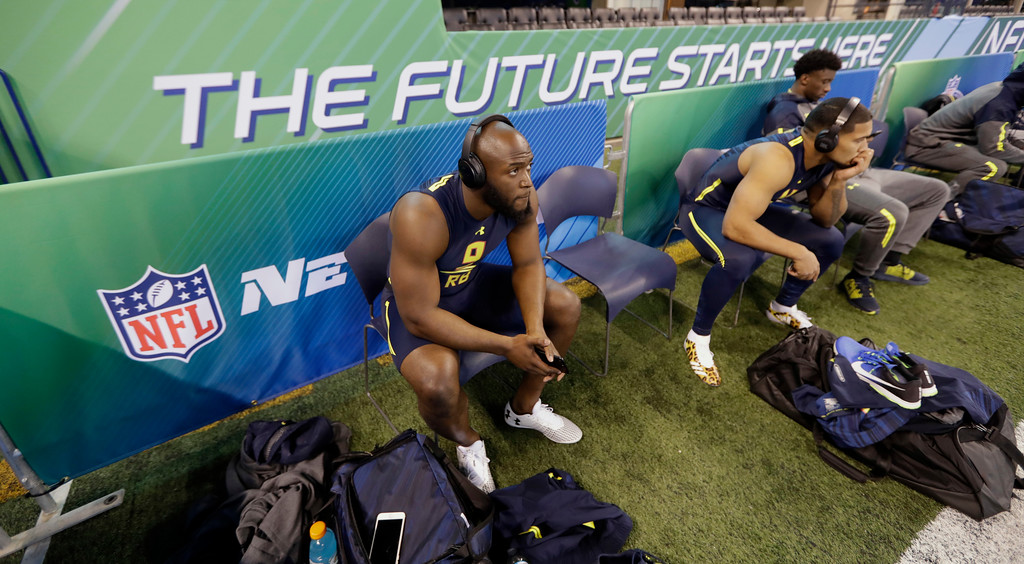 . LSU running back Leonard Fournette prepares for the 40-yard dash at the NFL football scouting combine Friday, March 3, 2017, in Indianapolis. (AP Photo/David J. Phillip)