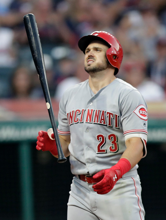 . Cincinnati Reds\' Adam Duvall tosses his bat after striking out against Cleveland Indians starting pitcher Mike Clevinger in the sixth inning of a baseball game, Monday, July 9, 2018, in Cleveland. (AP Photo/Tony Dejak)
