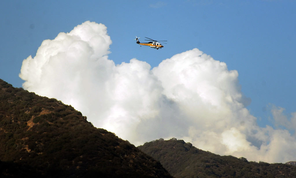 . Los Angeles County Firefirghters with aid of water dropping helicopters battle a five acre brush fire in the San Gabriel Mountains above Azusa just above the former Shooting range on Tuesday, Aug. 27, 2013 in Azusa, Calif.   (Keith Birmingham/Pasadena Star-News)