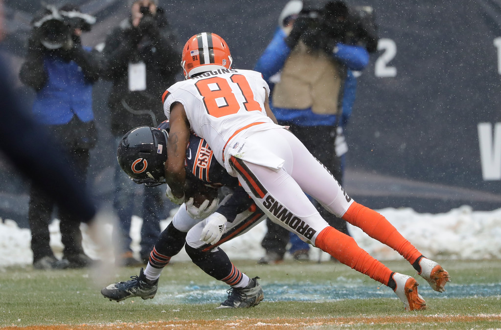. Cleveland Browns wide receiver Rashard Higgins (81) tackles Chicago Bears cornerback Prince Amukamara (20) after fumbling a reception into the end zone that Amukamara recovered in the second half of an NFL football game in Chicago, Sunday, Dec. 24, 2017. (AP Photo/Nam Y. Huh)