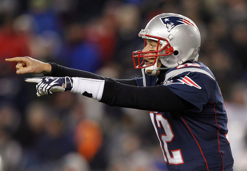 . New England Patriots quarterback Tom Brady gestures to his team mates during the first half of their NFL football game against the Miami Dolphins in Foxborough, Massachusetts December 30, 2012. REUTERS/Jessica Rinaldi