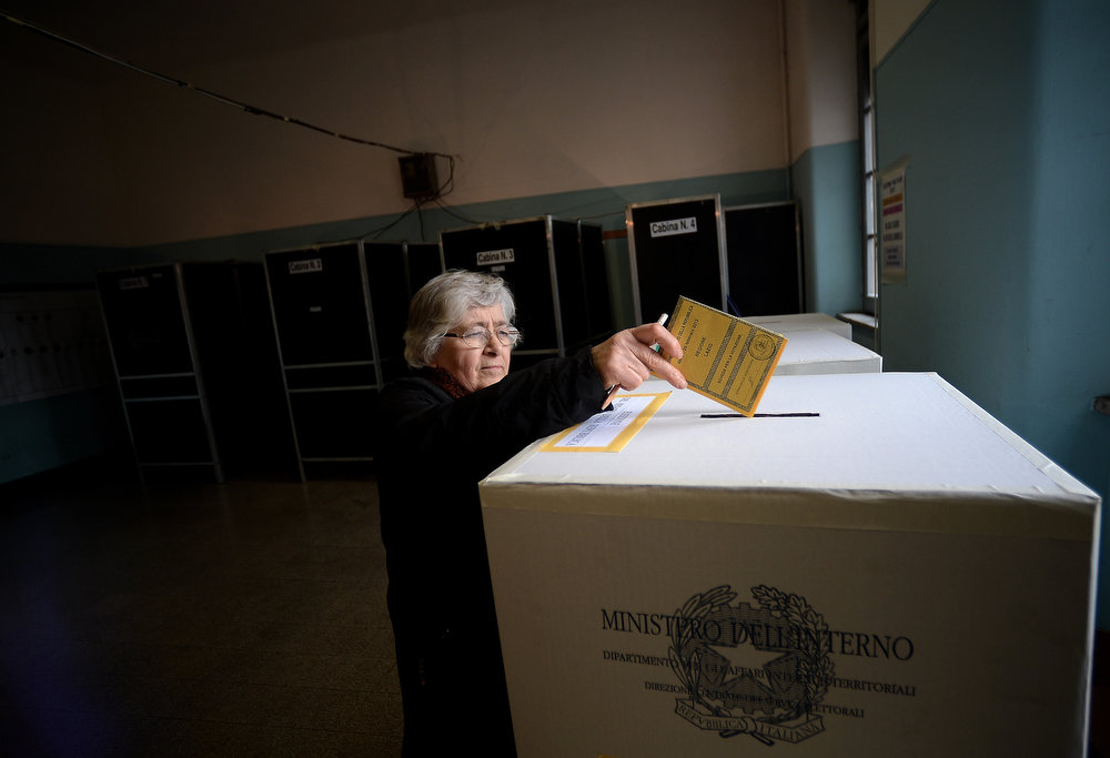 . A woman casts her vote at a polling station in Rome on February 24,2013, as part of Italy\'s general elections. Italians fed up with austerity voted on Sunday in the country\'s most important election in a generation, as Europe held its breath for signs of fresh instability in the eurozone\'s third economy.  FILIPPO MONTEFORTE/AFP/Getty Images
