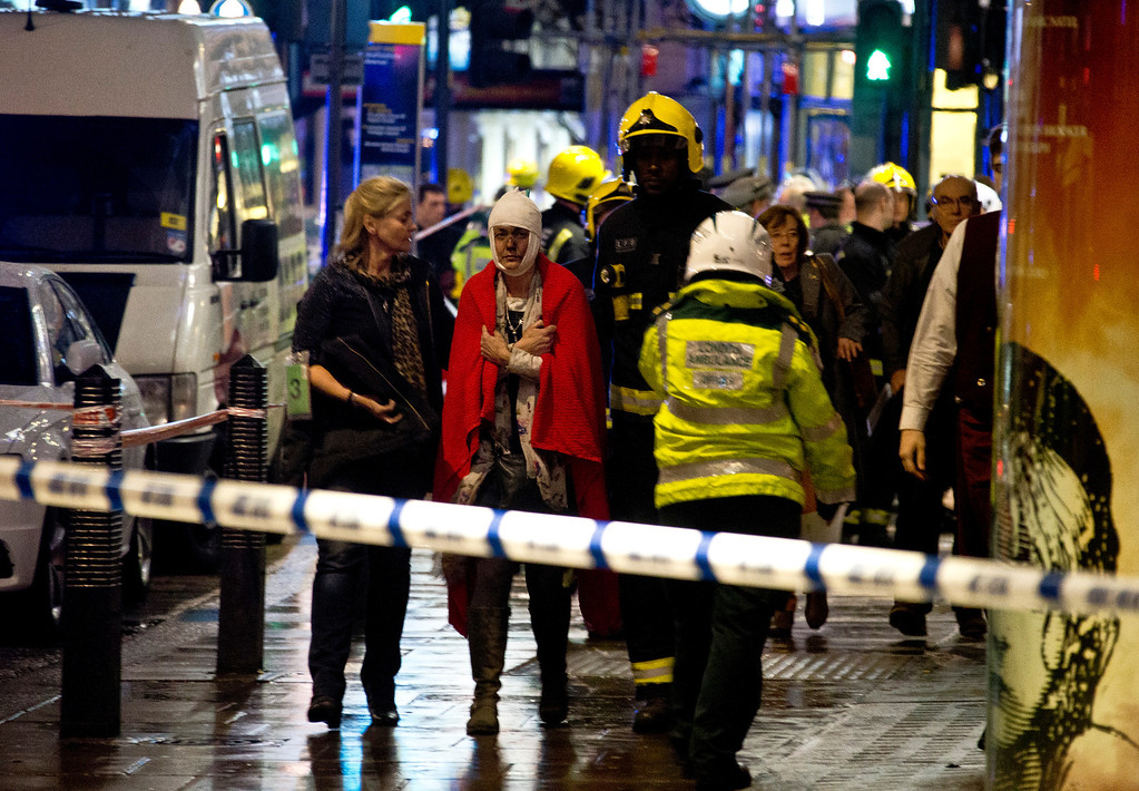 ". A woman stands bandaged and wearing a blanket  given by emergency services  following an incident at the Apollo Theatre, in London\'s Shaftesbury Avenue, Thursday evening, Dec. 19, 2013, during a performance at the height of the Christmas season, with police saying there were ""a number\"" of casualties. It wasn\'t immediately clear if the roof, ceiling or balcony had collapsed  during a performance. Police said they \""are aware of a number of casualties,\"" but had no further details. (AP Photo by Joel Ryan, Invision)"