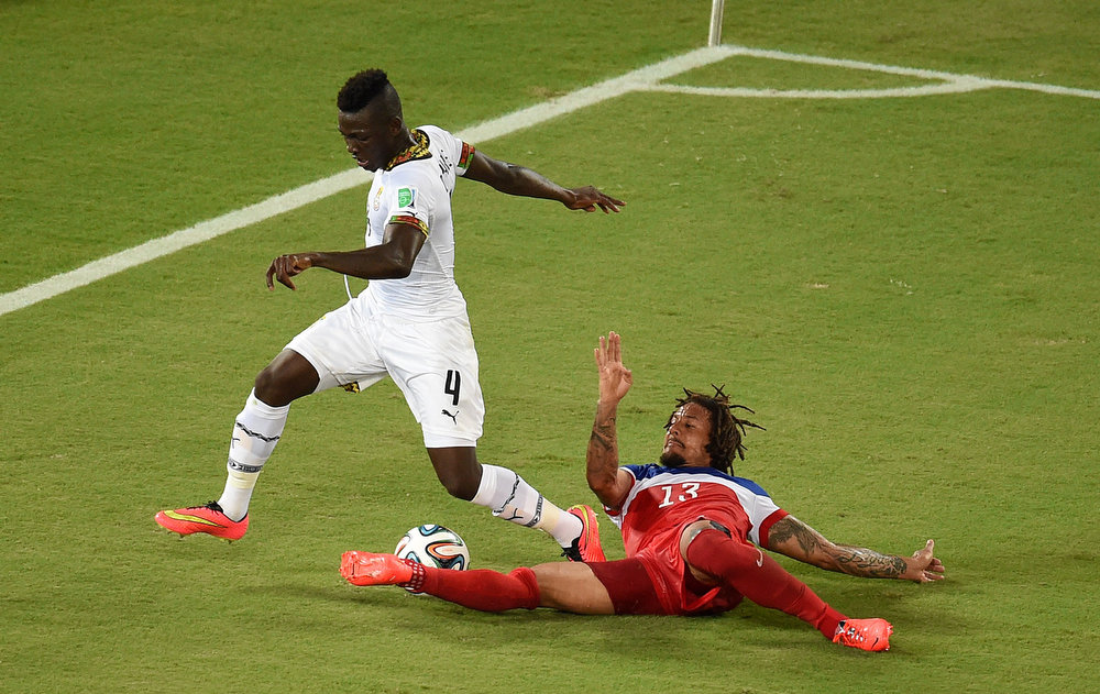 Description of . Ghana's defender Daniel Opare (L) vies with US midfielder Jermaine Jones (R) during a Group G football match between Ghana and US at the Dunas Arena in Natal during the 2014 FIFA World Cup on June 16, 2014.  AFP PHOTO / JAVIER SORIANOJAVIER SORIANO/AFP/Getty Images