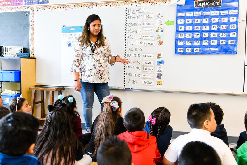 Second-grade teacher Escarlett Trujillo-Caldera teaches her class the schedule. Back to school day at Hallman Elementary School on Wednesday, September 4, 2019 in Salem, Ore.