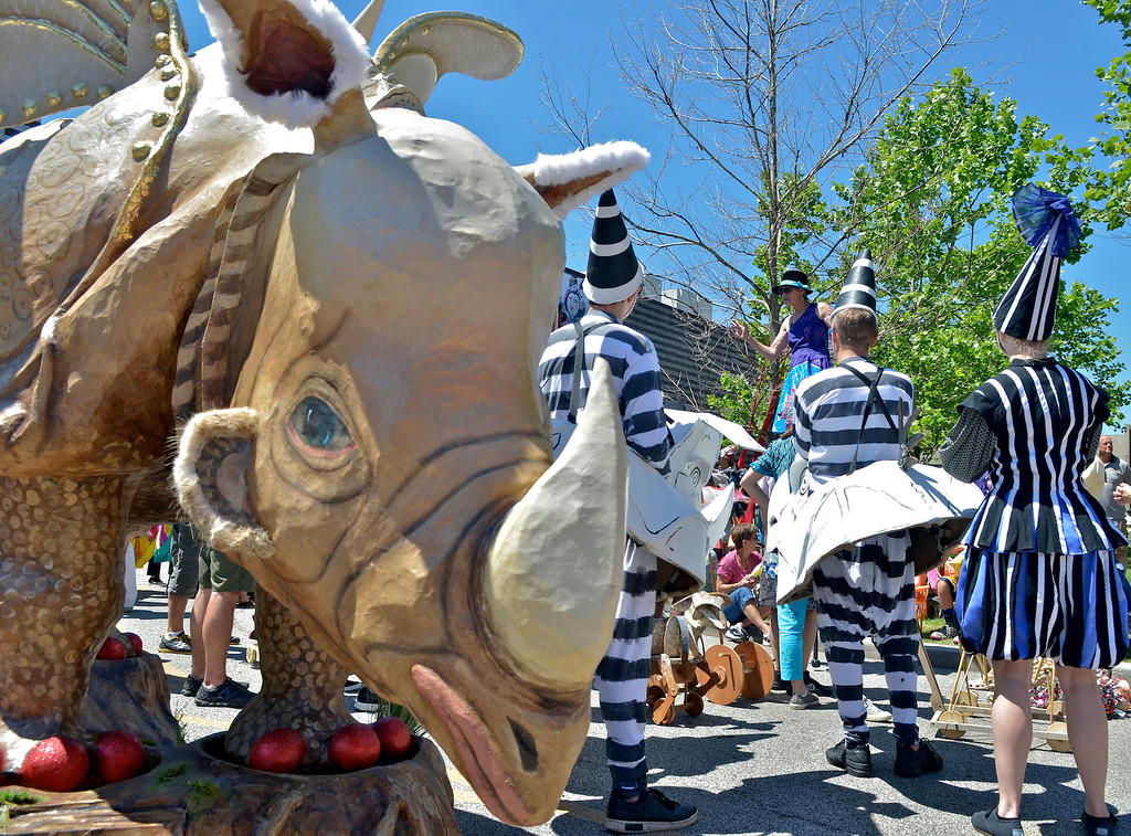 . Jeff Forman/JForman@News-Herald.com Robin Van Lear, director of the parade, talks to participants before the start of the Cleveland Museum of Art 25th annual Parade the Circle June 14 in University Circle. Van Lear sculpted the rhinoceros for the first parade and included it in this anniversary run.