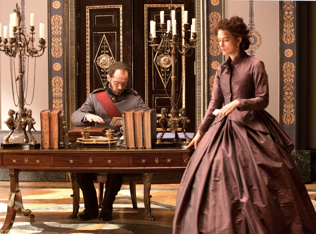 . BEST HOME OFFICE AND GRAND CHAISE: Anna Karenina�s husband, here played by Jude Law, works in his austere office filled with neoclassical details. The rustic yet noble snow-covered wooden structures that made up the estate in �Anna Karenina� won the top award. (Laurie Sparham/Focus Features)