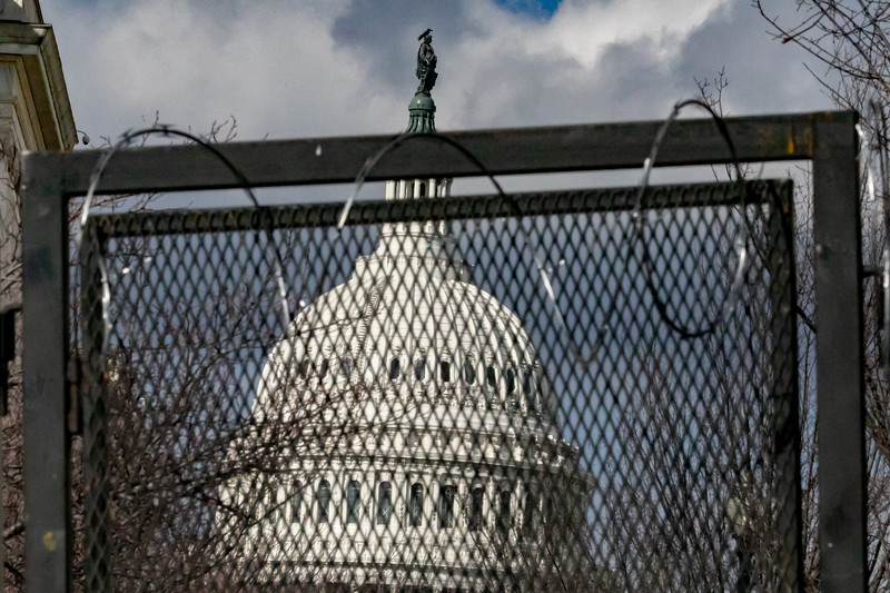 The U.S. Capitol is seen behind barbed wire fence during inauguration ceremonies