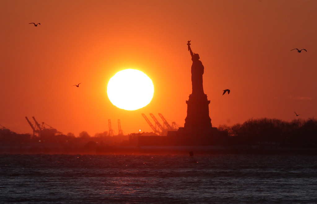 . The Statue of Liberty seen from the Brooklyn waterfront in New York on Sunday, Feb. 15, 2015. (AP Photo/Peter Morgan)