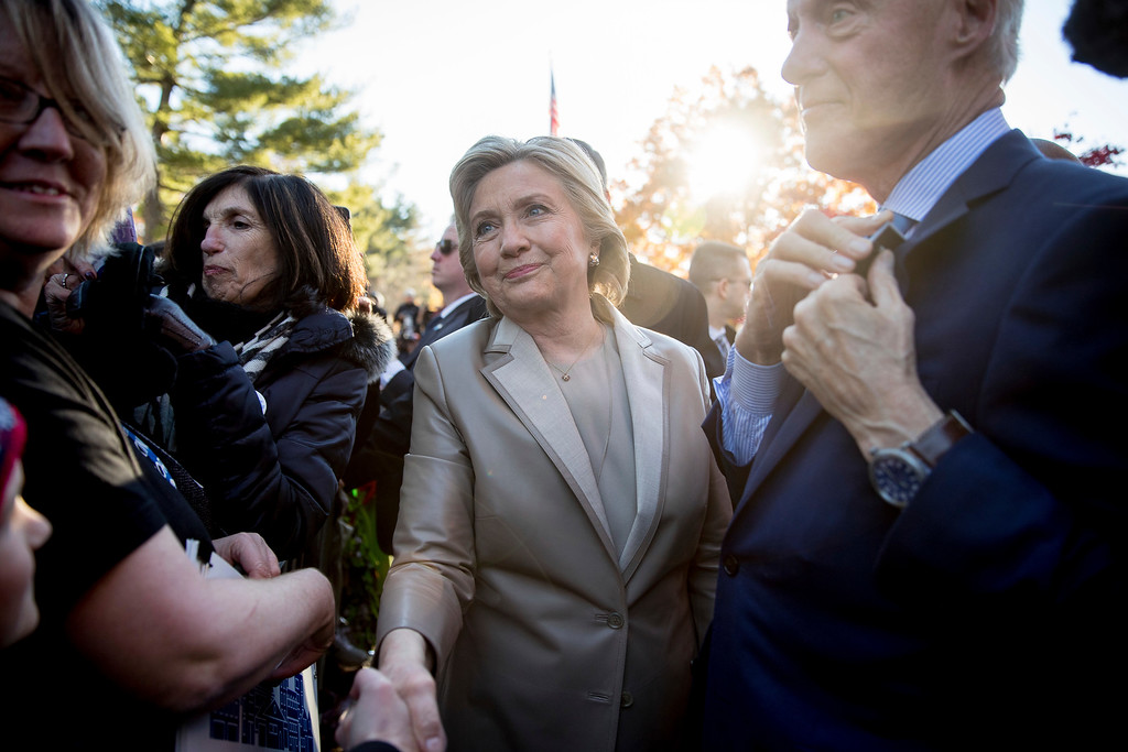 . Democratic presidential candidate Hillary Clinton, accompanied by her husband, former President Bill Clinton, right, greets supporters outside Douglas G. Grafflin School in Chappaqua, N.Y., Tuesday, Nov. 8, 2016, after voting. (AP Photo/Andrew Harnik)