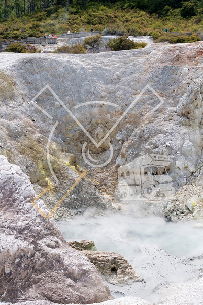 Steam rising up from a sulfur convered hot pool crater at Wai-O-Tapu geothermal area in Rotorua