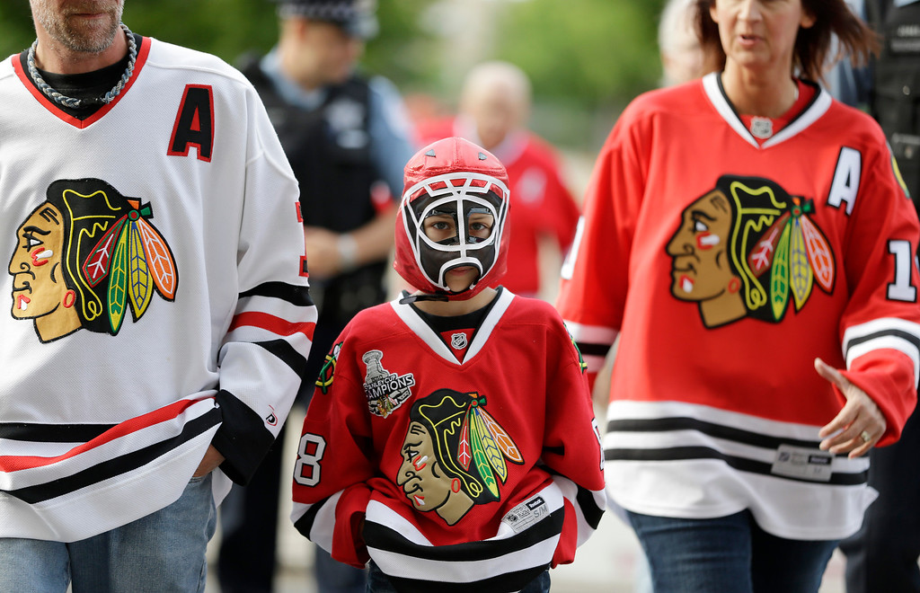 . Ten-year-old Chicago Blackhawks fan Nick Woods arrives at the United Center for Game 5 of the NHL hockey Stanley Cup playoffs Western Conference finals between the Blackhawks and the Los Angeles Kings, Saturday, June 8, 2013, in Chicago. (AP Photo/Nam Y. Huh)