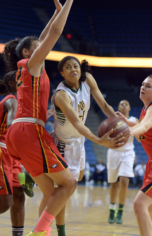 . Poly\'s Arica Carter throws up a shot as she\'s defended by Etiwanda\'s Daeja Smith at Citizens Business Bank Arena in Ontario, CA on Saturday, March 22, 2014. Long Beach Poly vs Etiwanda in the CIF girls open division regional final. 1st half, Photo by Scott Varley, Daily Breeze)