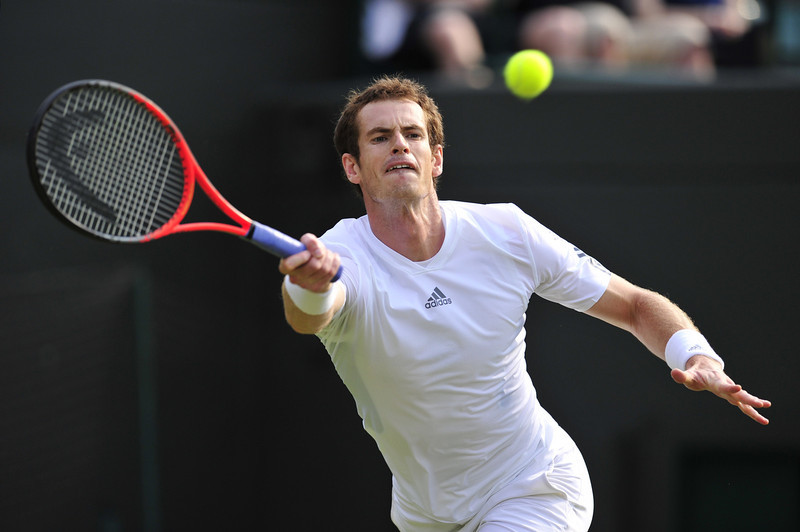. Britain\'s Andy Murray returns against Taiwan\'s Lu Yen-Hsun during their second round men\'s singles match on day three of the 2013 Wimbledon Championships tennis tournament at the All England Club in Wimbledon, southwest London, on June 26, 2013. GLYN KIRK/AFP/Getty Images
