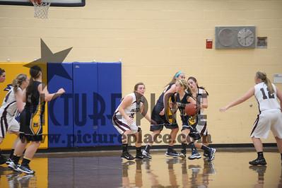 MHS Girls action Basketball Vs. South St.Paul