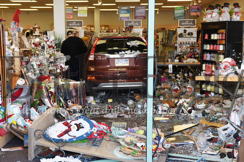 Harold Aughton/Butler Eagle: A woman drove her Honda CR-V throught the window of the Hallmark store front at Butler Commons Wed., Nov. 13, 2019.