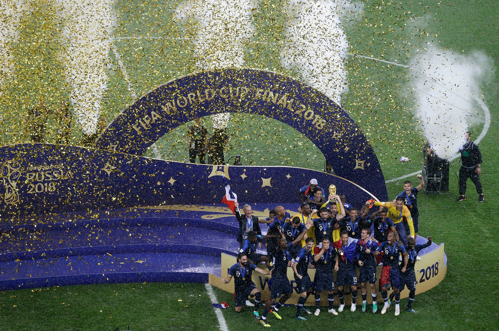 . French players celebrate with the trophy at the end of the final match between France and Croatia at the 2018 soccer World Cup in the Luzhniki Stadium in Moscow, Russia, Sunday, July 15, 2018. (AP Photo/Thanassis Stavrakis)