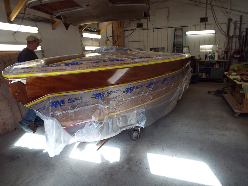 Final coat of epoxy applied to the port top plank.