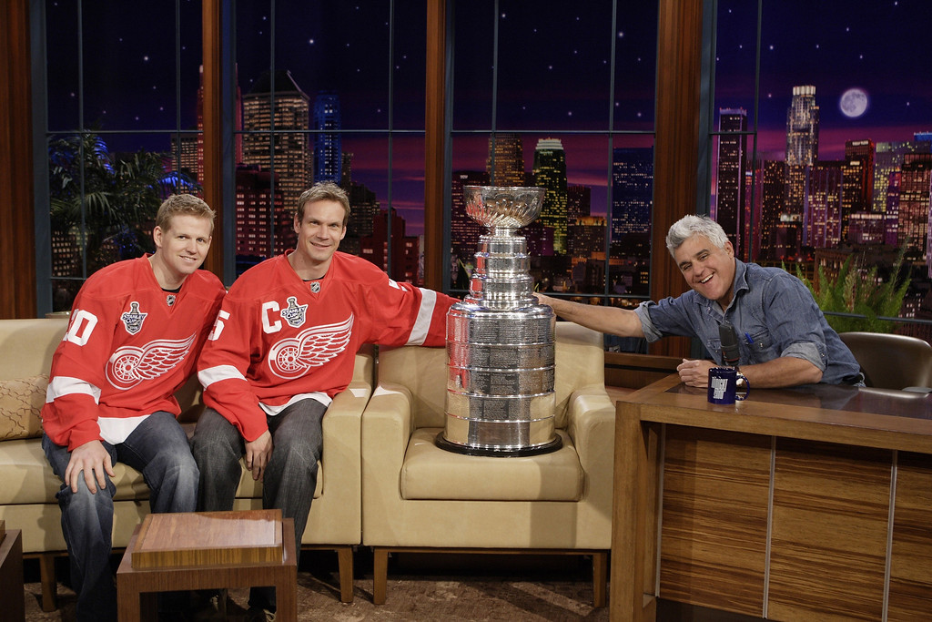 ". In this photo provided by NBC, from left, Detroit Red Wings hockey players Chris Osgood and Nicklas Lidstrom, from Sweden, and host Jay Leno are shown with the Stanley Cup trophy prior to the taping of ""The Tonight Show with Jay Leno\"" in Burbank, Calif., Tuesday June 10, 2008. (AP Photo/NBC, Margaret Norton) ** EDITORIAL USE ONLY, NO SALES, NO ARCHIVES **"