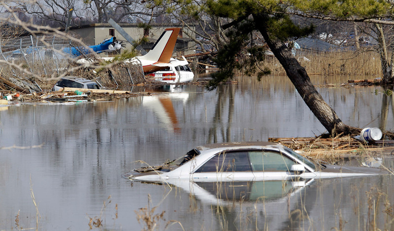 . Washed out vehicles and light planes are submerged at Sendai airport following a massive Tsunami triggered by a huge earthquake in Sendai, northern Japan,  Saturday, March 12, 2011.(AP Photo/Koji Sasahara)