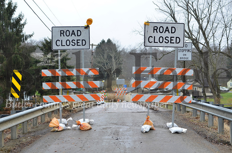 The single lane bridge where Meridian Road crosses the Connoquenessing Creek is closed following a semi-truck crash on Dec. 31. Tanner Cole/Butler Eagle