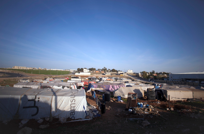 . This Friday, April 5, 2014 photo shows a general view of an unofficial Syrian refugee camp on the outskirts of Amman, Jordan. Some residents, frustrated with Zaatari, the region\'s largest camp for Syrian refugees, set up new, informal camps on open lands, to escape tensions and get closer to possible job opportunities.(AP Photo/Khalil Hamra)