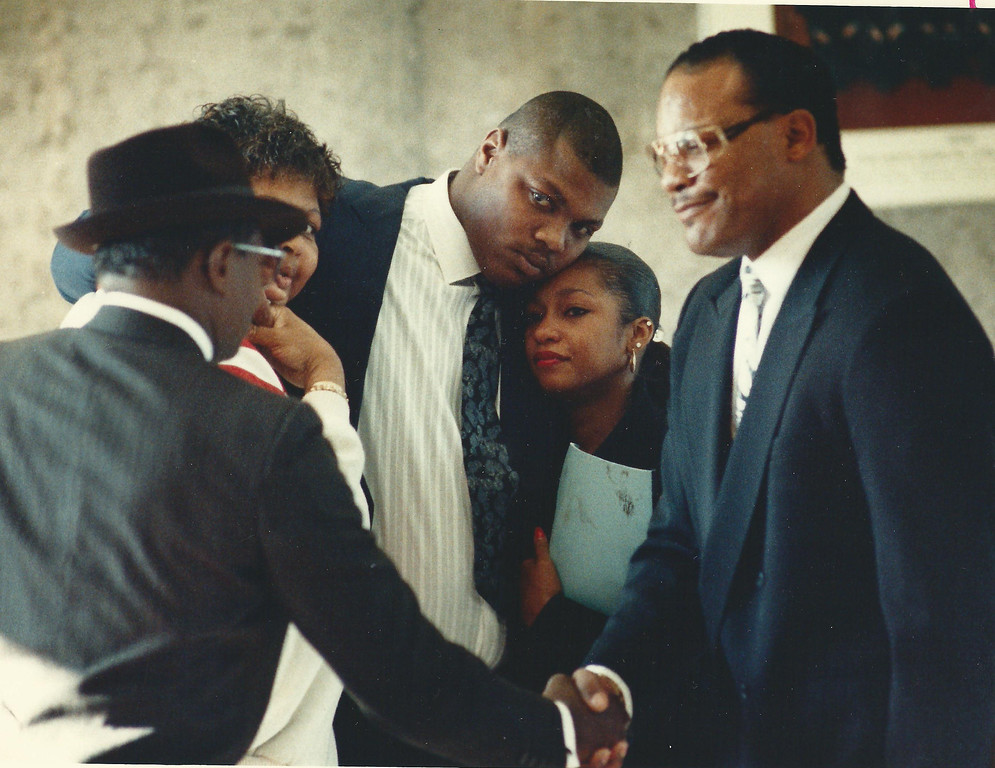 . Former Lions player Reggie Rogers (center) with family and attorney Elbert Hatchett (right) outside a courtroom in Oakland County Circuit Court in December 1989. Oakland Press file photo