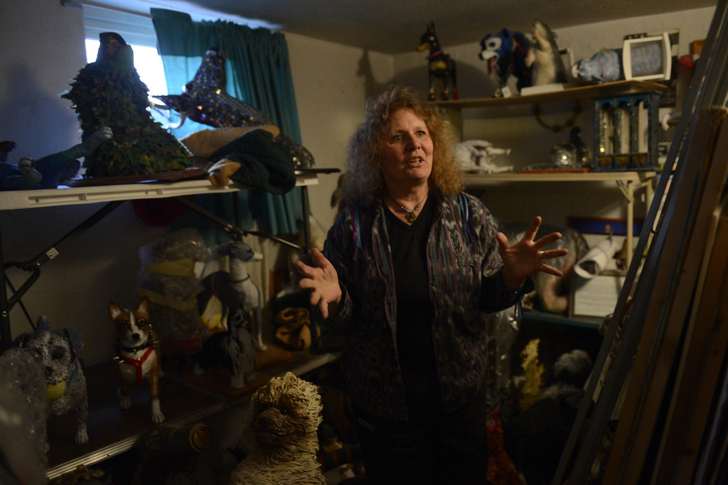 . Edgewater, CO. - January 28:  Artist Dede LaRue in the kennel / stable where she keeps all of her finished work in her home studio in Edgewater, Colorado. January 28, 2013. (Photo By Joe Amon / The Denver Post)